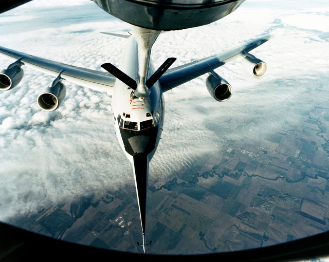 An in-flight view from the boom operator's window of the refueling connection of a KC-135A Stratotanker aircraft refueling a KC-135R Stratotanker