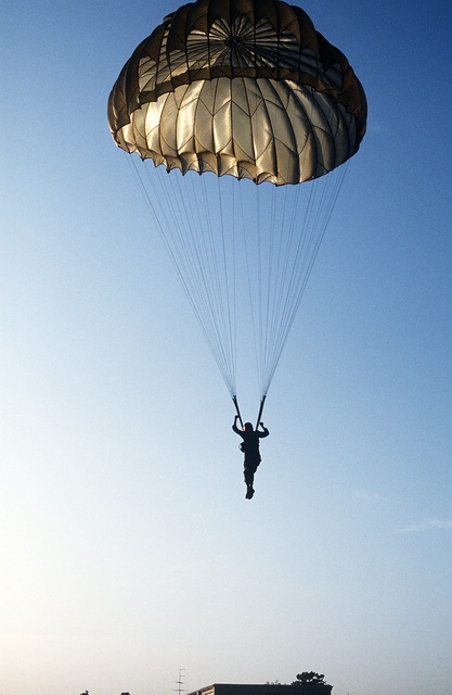 A trainee prepares to hit the ground while undergoing jump school training during multi-national ranger training at the Dahlonega Ranger Camp