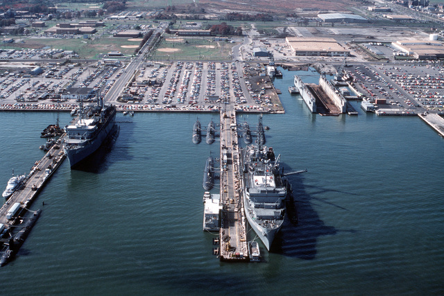 Aerial view of the submarine tenders USS EMORY S. LAND (AS-39) and USS L. Y. SPEAR (AS-36) at the Destroyer and Submarine Piers and the surrounding area