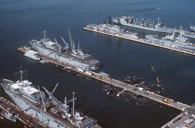 Aerial view of the submarine tenders USS EMORY S. LAND (AS-39) and USS L. Y. SPEAR (AS-36) at the Destroyer and Submarine Piers