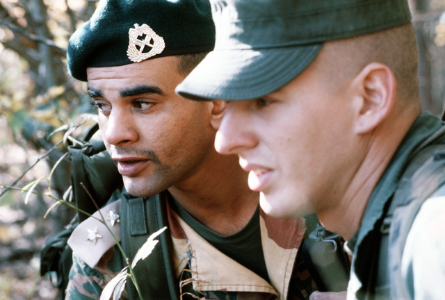 LT Hamad Al-Angari of Kuwait and PFC David Howard of the United States discuss operations during multi-national ranger training at the Dahlonega Ranger Camp