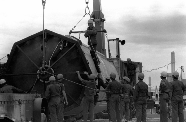 Members of the 390th Missile Maintenance Squadron prepare stage one of a Titan II intercontinental ballistic missile (ICBM) for transport from site 571-6 to Davis-Monthan Air Force Base, Arizona