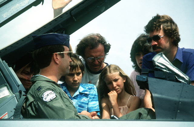 An F-16 Fighting Falcon aircraft pilot explains the aircraft to Royal Australian Air Force families during the open house. The pilot is assigned to the 35th Tactical Fighter Squadron, 8th Tactical Fighter Wing, involved in Exercise Sandgroper '82