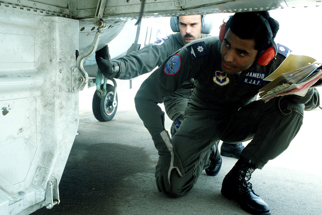 Royal Jordanian Air Force 2LT Mohammed Hameid and CPT Tim McGilvra perform a pre-flight inspection of a T-37 aircraft prior to flying a training mission