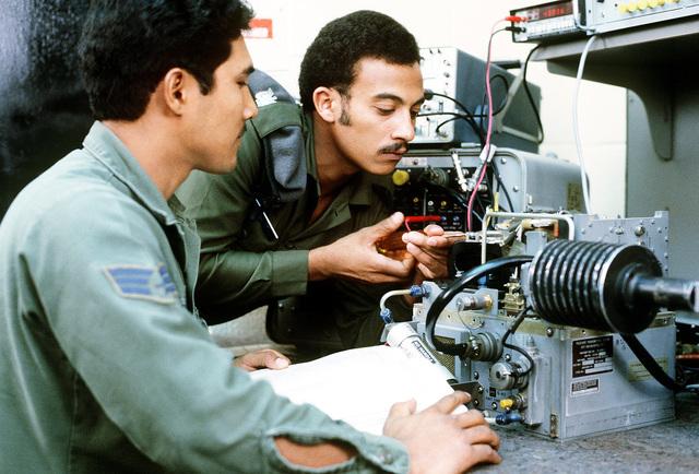 TSGT Jamil Ali Ghalib of Yemen fine-tunes an AN/APQ radar transmitter during a training class. SGT John Caparra observes