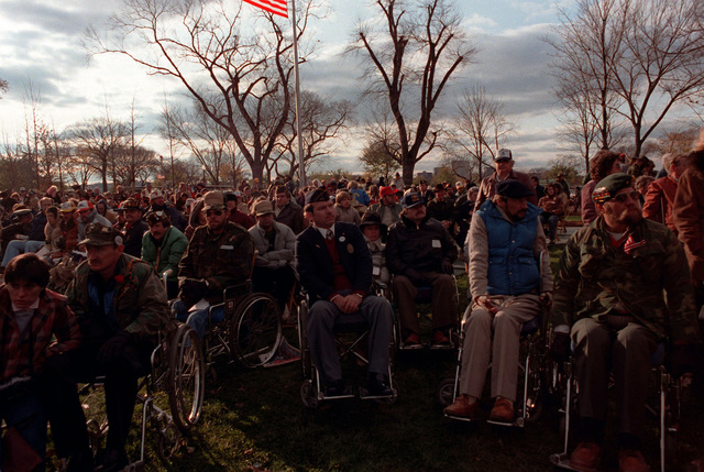 Disabled veterans attend a memorial service during the dedication day parade for the Vietnam Veterans Memorial