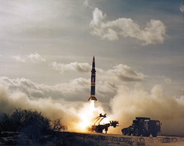 A Pershing II battlefield support missile is fired from an erector/launcher vehicle on McGregor Range