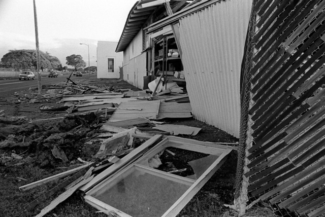 A view of a supply warehouse (Building #1017) that was damaged by high winds during by Hurricane Iwa
