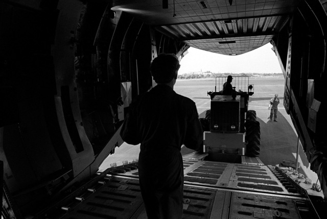 A portable electric power generator is loaded aboard a C-141B Starlifter aircraft for shipment to Kauai, Hawaii. The generator is being airlifted to Kauai to provide power to areas left without electricity by Hurricane Iwa