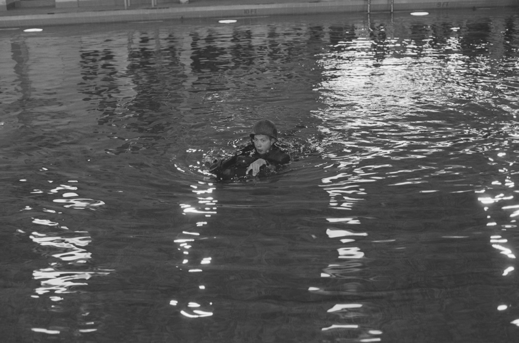 A recruit demonstrates water survival techniques for visitors with a Minneapolis, Minnesota, command visit tour