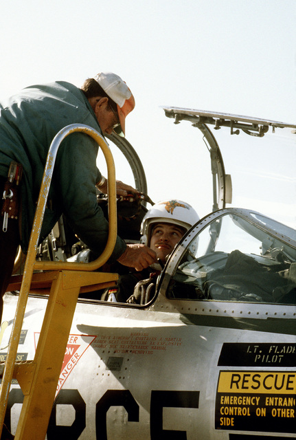 A crew chief assists a German pilot as he pre-flights an F-104G Starfighter aircraft, prior to a training flight conducted by members of the 69th Tactical Fighter Training Squadron
