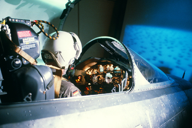 LT. J. G. Reinhard Dresbach of the West Germany Navy sits in the F-104 Starfighter aircraft simulator, during the training of German pilots conducted by the 69th Tactical Fighter Training Squadron