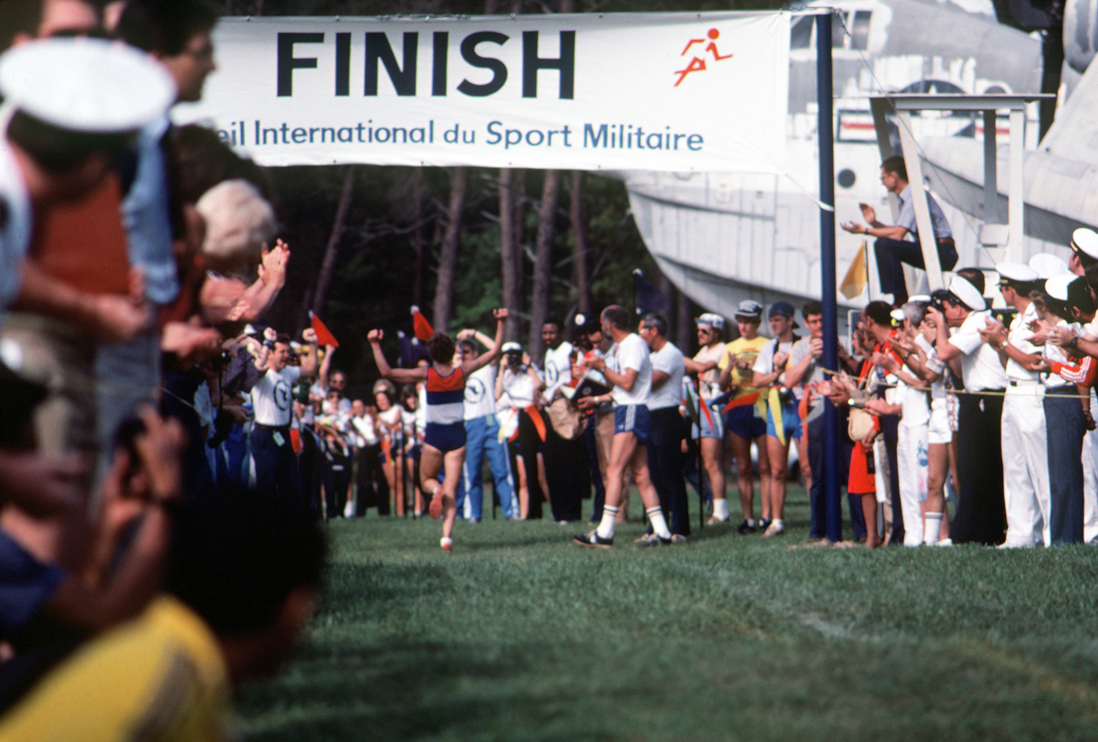 A participant in the 31st Conseil International du Sport Militaire (CISM) crosses the finish line to win one of the running events. The CISM is an annual meeting of military athletes from all over the world