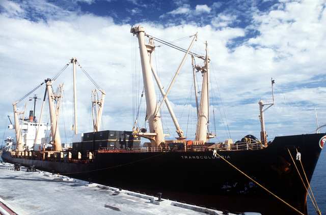 A port bow view of the cargo ship TRANSCOLUMBIA, the first ship to tie up to the petroleum-oil lubricant pier