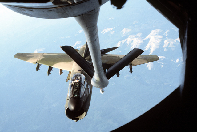 An air-to-air view, as seen from the boom section of a KC-135A Stratotanker aircraft, of an A-7D Corsair II aircraft as it approaches for refueling