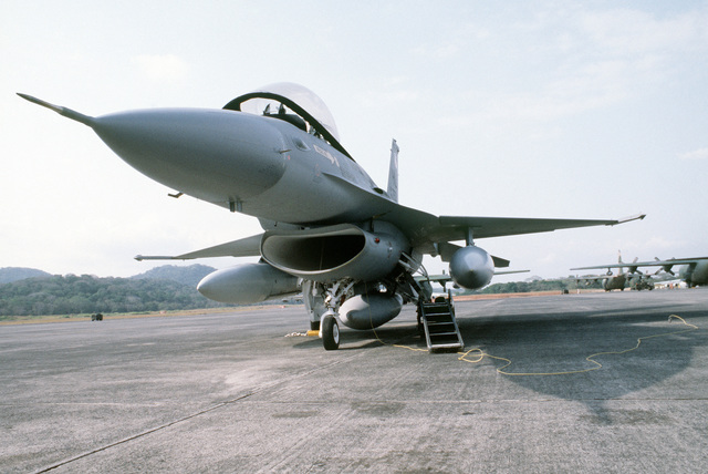An F-16 Fighting Falcon aircraft with fuel tanks attached is ready for redeployment during Exercise KINDLE LIBERTY 83