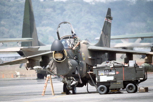 Maintenance is performed on an A-7 Corsair II aircraft by members of the 180th Tactical Fighter Group during Exercise KINDLE LIBERTY 83