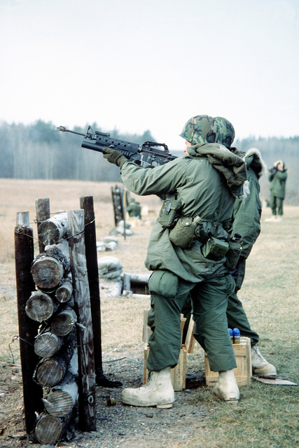 Members of the 26th Marine Amphibious Unit practice firing the M-203 40mm grenade launcher that is mounted on a M-16A1 rifle. They are here participating in Exercise Alpine Warrior '82