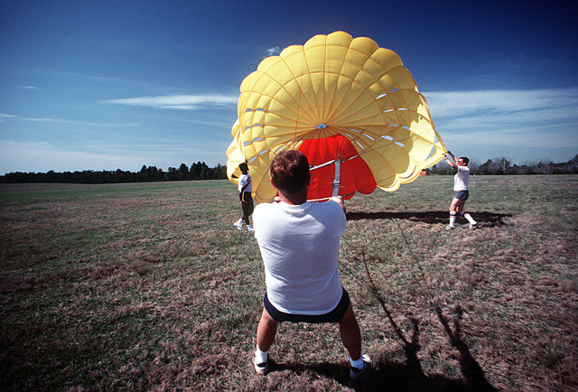 Survival training instructors test a parasail before it is used in training at the Naval Aviation Schools Command