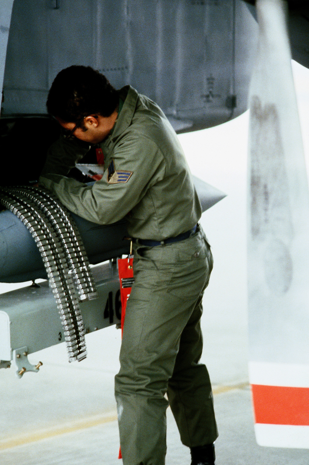A1C Aaron Franklin loads 7 62mm shells into the weapon
