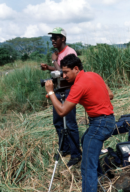 SPECIALIST Fourth Class Ivan Blanco, a television production specialist, videotapes a mass casualty simulation exercise while Claudio Hawkins assists