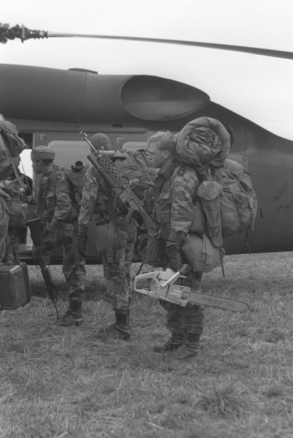 SPECIALIST Fourth Class Patrick Hawkins of Company B, 326th Training Battalion, boards a UH-60 Black Hawk helicopter with members of Company A, 1ST Battalion, 501st Infantry. Hawkins is attached to Company A as a combat engineer during Exercise EAGLE STRIKE III