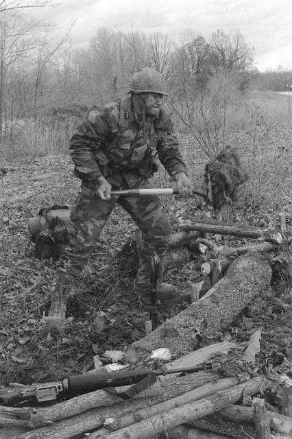 STAFF Sergeant Lave Jr. of Company B, 1ST Battalion 327th Infantry constructs a defensive postion during a training exercise