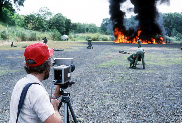 William Cottrell, a civilian television production specialist, videotapes a mass casualty simulation exercise