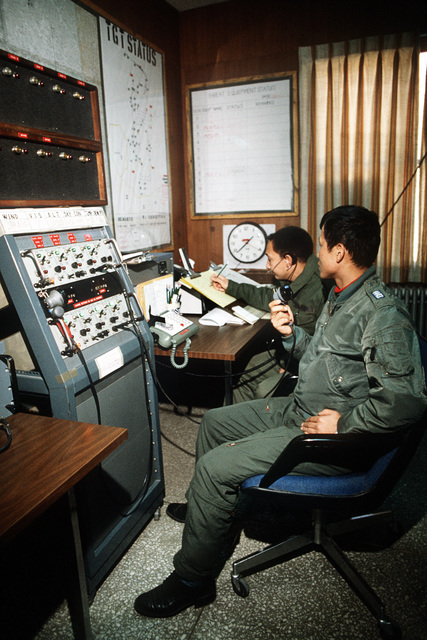 SSGT Marvin J. Green, a range monitor, and CPT Cha Ki Su, a Korean F-5 Tiger II aircraft pilot and range operations officer, direct air traffic from the range control room at the Korean Operational Tactical Air Range (KOTAR), during exercise Commando Crest