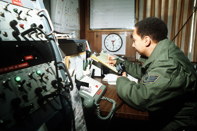 SSGT Marvin J. Green, a range monitor at the Korean Operational Tactical Air Range (KOTAR), clears aircraft into range airspace during exercise Commando Crest. Upon granting aircraft clearance, SGT Green records the call sign, type, time on range and purpose in his air traffic log