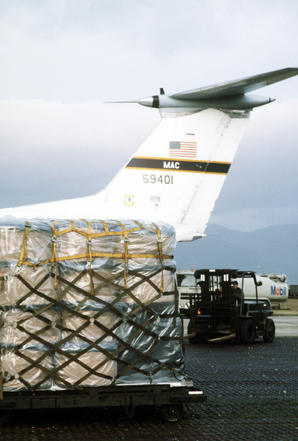 Silivo Gatto uses a forklift to move relief supplies into position for loading aboard a C-141B Starlifter aircraft. The supplies are being airlifted by the 437th Military Airlift Wing to the victims of an earthquake in North Yemen