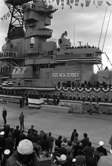 An overall view of the recommissioning ceremony for the battleship USS NEW JERSEY (BB-62) as crewmen man the rail