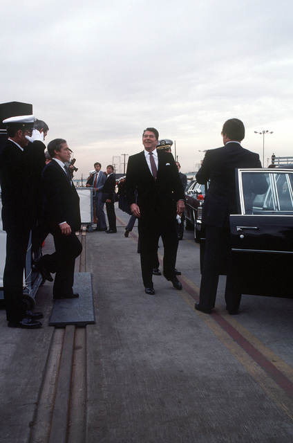 President Ronald Reagan prepares to get into his limousine at the conclusion of the recommissioning ceremony for the battleship USS NEW JERSEY (BB-62)