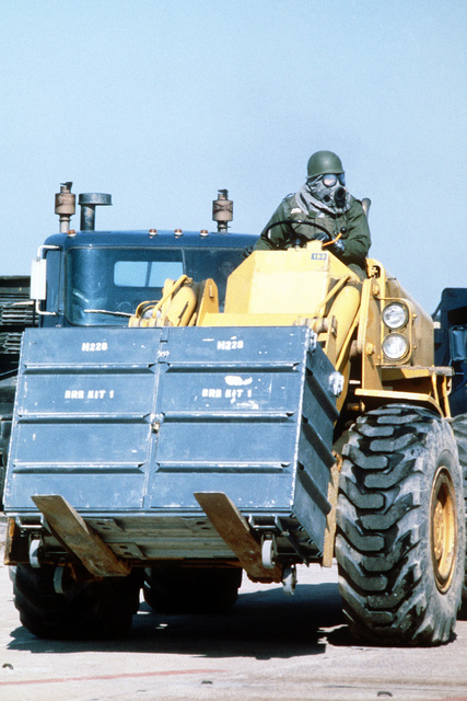 A civil engineering specialist moves a rapid runway repair kit into place with a forklift during Exercise Team Spirit '81