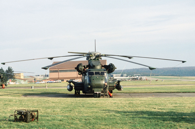 A front view of an Air-Ground Operations System (AGOS) CH-53 helicopter on display on the flight line