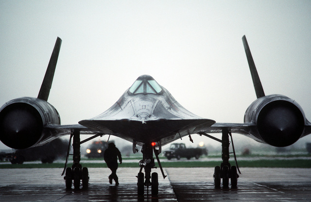 A front view of an SR-71 Blackbird aircraft being prepared for takeoff. The SR-71 is flown by Det. 4, 9th Strategic Reconnaissance Wing, 3rd Air Force, RAF Mildenhall