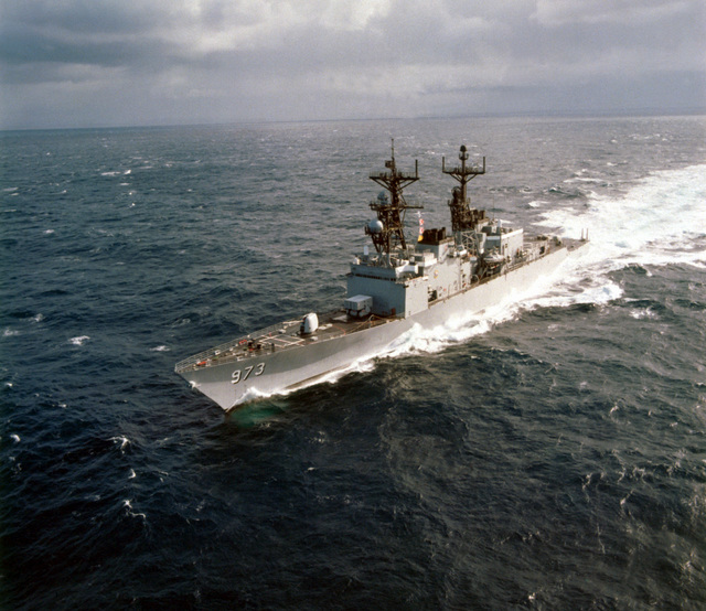 Aerial port bow view of the Spruance Class destroyer USS JOHN YOUNG (DD-973) underway. The ship is equipped with the MK-23 target acquisition system radar