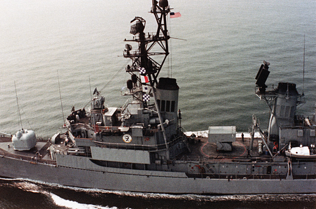 An aerial (close-in) port beam view of the guided missile destroyer USS RICHARD E. BYRD (DDG 23) underway