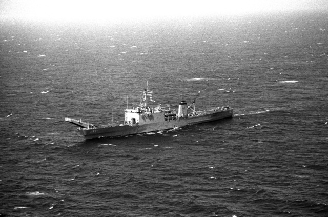 An aerial port bow view of the Newport class tank landing ship USS PEORIA (LST 1183) underway