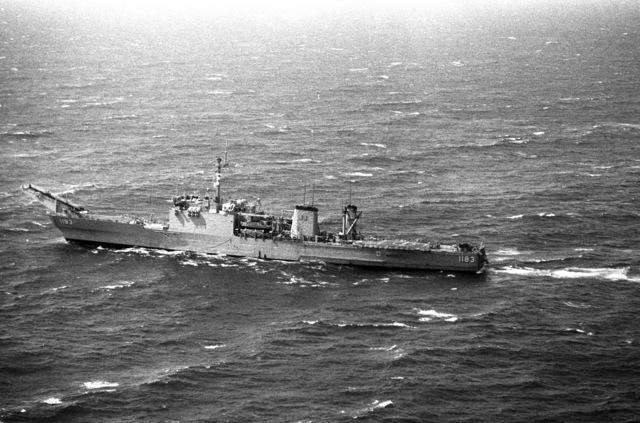 An aerial port quarter of the Newport class tank landing ship USS PEORIA (LST 1183) underway. (SUBSTANDARD)