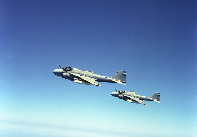 An air-to-air left side view of two A-6E Intruder aircraft assigned to the nuclear-powered aircraft carrier USS DWIGHT D. EISENHOWER (CVN 69)