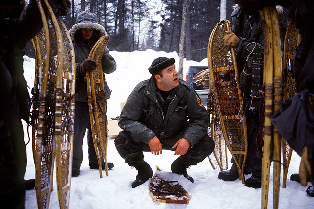 An instructor from the fleet Aviation Specialized Operational Training Group Atlantic (FASO), teaches snowshoeing to students of the Navy's Cold Weather Environmental Survival Training