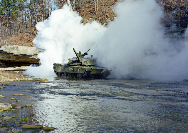 An M-1 Abrams main battle tank assigned to the 1ST Plt., Troop E, 2nd Bn., 6th Cav., lays down a smoke screen while on maneuvers at the U.S. Army Armor Center
