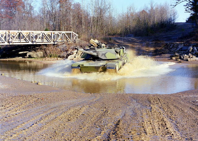 An M-1 Abrams main battle tank crosses a shallow river while on maneuvers at the U.S. Army Armor Center