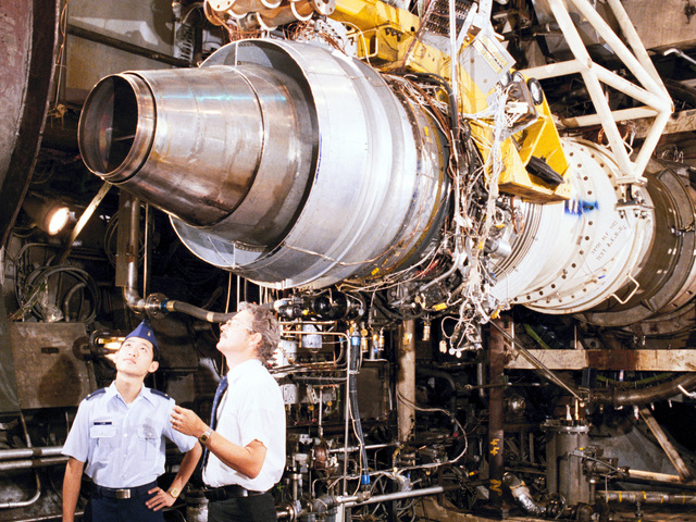 LT. Geoffrey Lum, a test operations engineer and Milton McIlveen, project manager from Sverdrup Technology, discuss test preparations for the AVCO Lycoming ALF502R-3 turbofan an engine, which powers the British Aerospace 146 medium-range transport aircraft