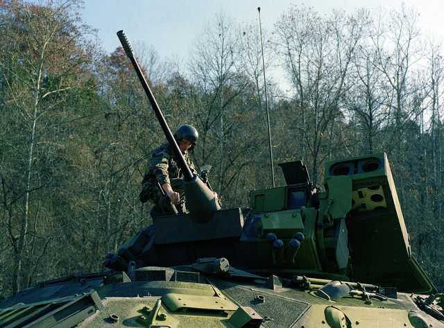 PFC Jackie L. Grider, 3rd Plt., E Trp., 2nd Bn., 6th Cav., works on the aerial sight of a 25mm cannon mounted in the turret of an M-2 Bradley cavalry fighting vehicle. The 3rd Platoon is on maneuvers at the U.S. Army Armor Center