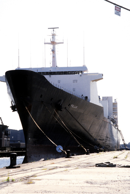 Port bow view of the Military Sealift Command cargo ship POLLUX (T-AK-290), tied to the pier while being renovated