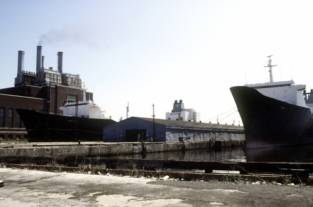 Port bow view of the Military Sealift Command cargo ships DENEBOLA (T-AK-289) (right) and POLLUX (T-AK-290), tied to the pier