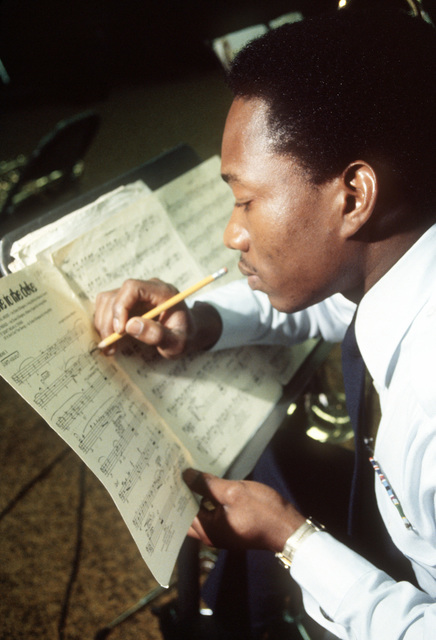 SRA Stanley McCoy, a member of the 604th Air University band, makes changes to his score during a practice session
