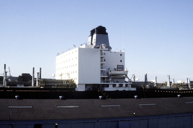 Starboard view of a Military Sealift Command cargo ship docked at the Naval Shipyard